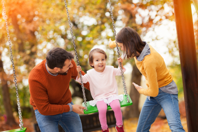 family playing at a park together